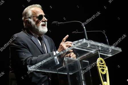Jonathan Goldsmith speaks on stage at the 60th Annual Clio Awards at The Manhattan Center on in New York