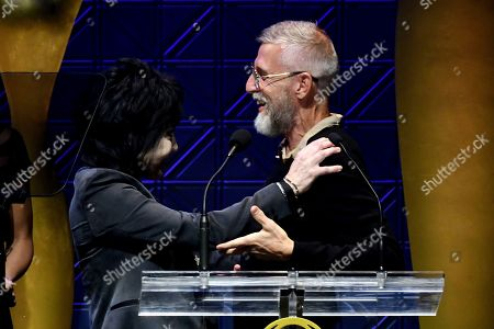 Stock Picture of Joan Jett accepts a Clio Award from presenter Todd Oldham at the 60th Annual Clio Awards at The Manhattan Center, in New York