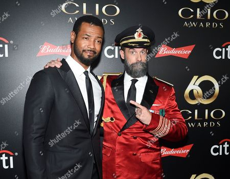 """Isaiah Mustafa, Brandon Moynihan. Actors Isaiah Mustafa, left, aka """"The Old Spice Guy"""" and Brandon Moynihan aka """"Captain Obvious"""" pose together at the 60th annual Clio Awards at The Manhattan Center, in New York"""