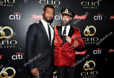 "Isaiah Mustafa, Brandon Moynihan. Actors Isaiah Mustafa, left, aka ""The Old Spice Guy"" and Brandon Moynihan aka ""Captain Obvious"" pose together at the 60th annual Clio Awards at The Manhattan Center, in New York"