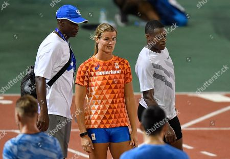 Dutch sprinter Dafne Schippers, left, stands beside Christian Coleman of the USA, right, during an evening training session at he Qatar Sports Club prior to the start of the World Athletics Championships in Doha, Qatar