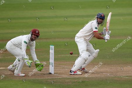 Alastair Cook in batting action for Essex as Steven Davies looks on from behind the stumps during Somerset CCC vs Essex CCC, Specsavers County Championship Division 1 Cricket at The Cooper Associates County Ground on 26th September 2019