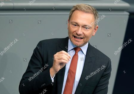 Christian Lindner, faction leader of the German Free Democratic Party, delivers a speech during a meeting of the German federal parliament, Bundestag, at the Reichstag building in Berlin, Germany
