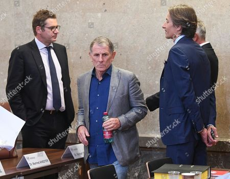 Defendants Peter Hochegger (C) and Karl-Heinz Grasser (R) attend another day of trial against them and other defendants at the Vienna District Criminal Court, in Vienna, Austria, 26 September 2019. Former Finance Minister Karl-Heinz Grasser and other defendants are facing charges of alleged fraud and corruption in connection with the privatization of the federal housing association 'Buwog'.