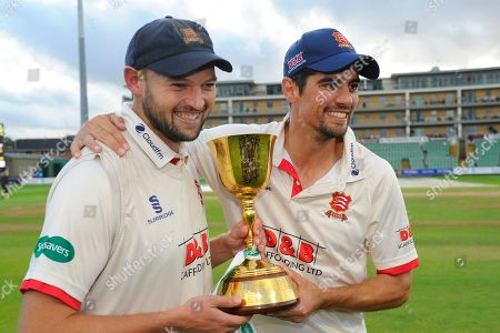 Nick Browne of Essex and Alastair Cook of Essex pose with the County Championship trophy during the Specsavers County Champ Div 1 match between Somerset County Cricket Club and Essex County Cricket Club at the Cooper Associates County Ground, Taunton