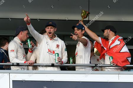 Jamie Porter of Essex and Alastair Cook of Essex celebrate on the team balcony during the County Championship title celebrations during the Specsavers County Champ Div 1 match between Somerset County Cricket Club and Essex County Cricket Club at the Cooper Associates County Ground, Taunton