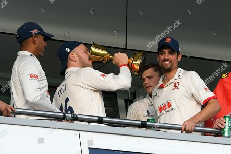 Sam Cook of Essex and Alastair Cook of Essex celebrate on the team balcony during the County Championship title celebrations during the Specsavers County Champ Div 1 match between Somerset County Cricket Club and Essex County Cricket Club at the Cooper Associates County Ground, Taunton