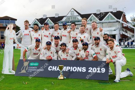 Ryan ten Doeschate of Essex and his players pose with the County Championship trophy with and a carboard cutout of Peter Siddle during the Specsavers County Champ Div 1 match between Somerset County Cricket Club and Essex County Cricket Club at the Cooper Associates County Ground, Taunton