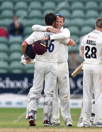 Marcus Trescothick of Somerset is hugged by Sir Alastair Cook of Essex as the game finishes in a draw and Essex win the title and Marcus Trescothick officially retires from playing during the Specsavers County Champ Div 1 match between Somerset County Cricket Club and Essex County Cricket Club at the Cooper Associates County Ground, Taunton