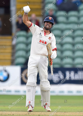 Alastair Cook of Essex celebrates as the teams shake hands for a draw and Essex win the County Championship during the Specsavers County Champ Div 1 match between Somerset County Cricket Club and Essex County Cricket Club at the Cooper Associates County Ground, Taunton
