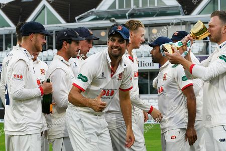 Alastair Cook of Essex turns to give a thumbs during the trophy celebrations up as Essex celebrate winning the County Championship during the Specsavers County Champ Div 1 match between Somerset County Cricket Club and Essex County Cricket Club at the Cooper Associates County Ground, Taunton