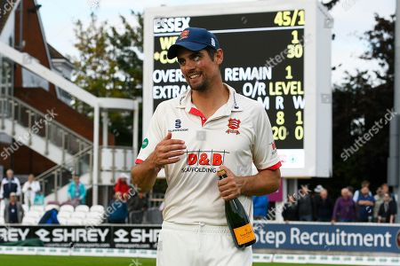Alastair Cook of Essex with a bottle of Champaigne ready for the trophy celebrations during the Specsavers County Champ Div 1 match between Somerset County Cricket Club and Essex County Cricket Club at the Cooper Associates County Ground, Taunton