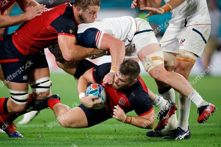England's Joe Launchbury carries the ball during the Rugby World Cup Pool C game at Kobe Misaki Stadium, against the United States in Kobe, Japan