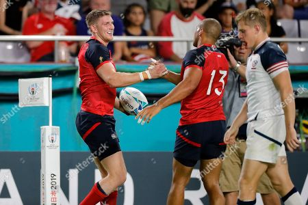 Stock Picture of England's Ruaridh McConnochie, left, celebrates with Jonathan Joseph (13)after scoring a try during the Rugby World Cup Pool C game at Kobe Misaki Stadium against the United States in Kobe, Japan