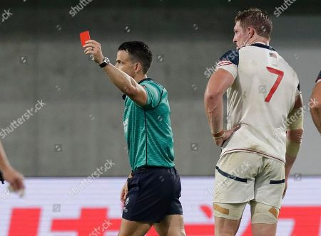 Referee Nick Berry shows a red card to United States' John Quill, right, during the Rugby World Cup Pool C game at Kobe Misaki Stadium, between England and the United States in Kobe, Japan