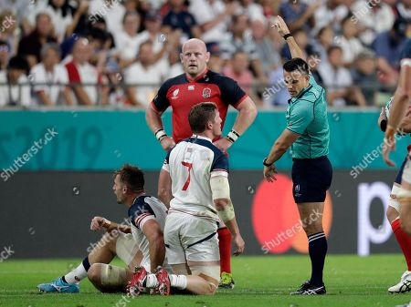 Referee Nick Berry, right, awards a penalty against the United States during the Rugby World Cup Pool C game at Kobe Misaki Stadium, between England and the United States in Kobe, Japan