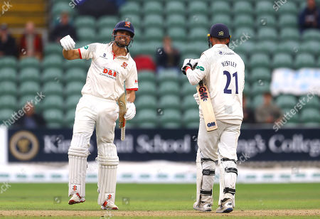 Sir Alastair Cook of Essex punches the air as he celebrates winning the County Championship