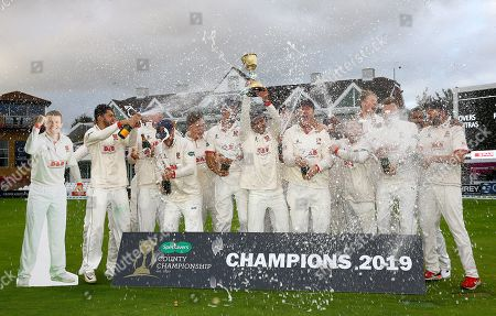 Essex celebrate with the County Championship trophy with, far left, a cardboard cutout of Peter Siddle