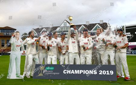 Stock Picture of Essex celebrate with the County Championship trophy with, far left, a cardboard cutout of Peter Siddle