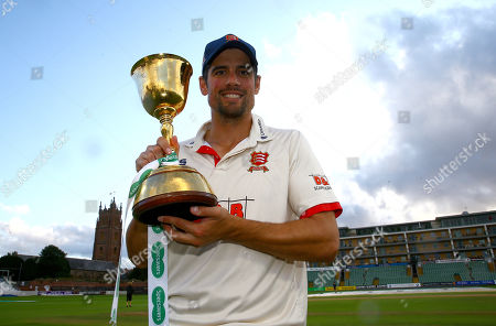 Sir Alastair Cook of Essex celebrates with the County Championship trophy