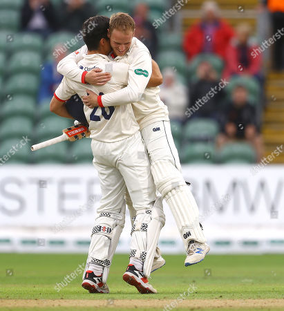 Sir Alastair Cook of Essex celebrates with team mate Tom Westley after winning the County Championship