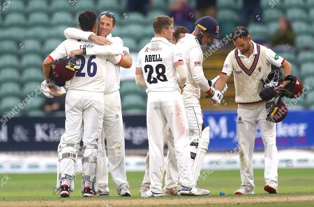 Marcus Trescothick of Somerset hugs Sir Alastair Cook of Essex after the end of play