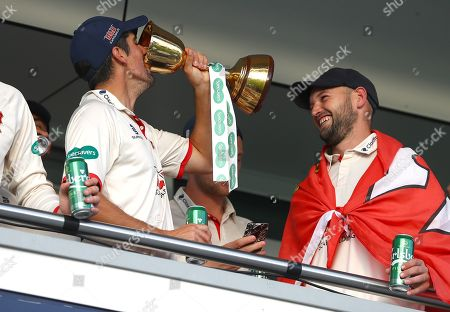 Sir Alastair Cook of Essex drinks the County Championship trophy