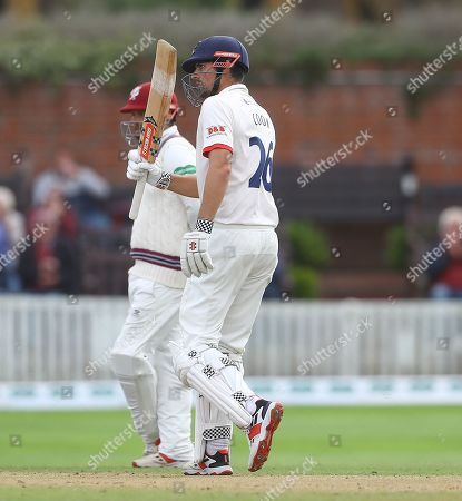 Sir Alastair Cook of Essex celebrates his 50