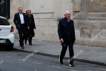 Francois-Henri Pinault, left, CEO of French luxury group Kering, and his father Francois Pinault, founder of the Pinault group, right, arrives outside French President Jacques Chirac's home in Paris. Jacques Chirac, a two-term French president who was the first leader to acknowledge France's role in the Holocaust and defiantly opposed the U.S. invasion of Iraq in 2003, has died at age 86
