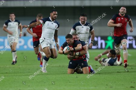 Ben Youngs (Down) of England is tackled by Hanco Germishuys of USA during the Rugby World Cup match between England and USA at Kobe Misaki Stadium, at in Kobe, Japan, 26 September 2019.