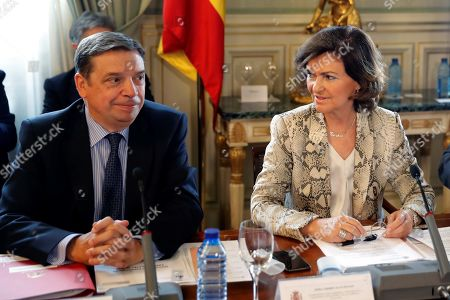 Acting Spanish Deputy Prime minister Carmen Calvo and Agriculture Minister Lluis Planas (L) attend a meeting focused on the coordination of the national administrations to deal with any possible scenes resulting from the Brexit, in Madrid, Spain, 26 September 2019.