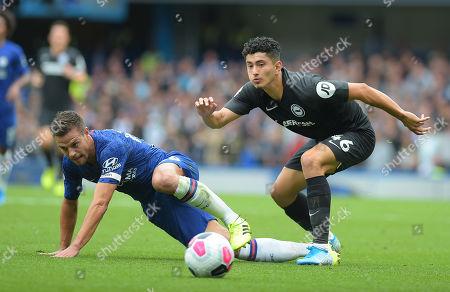 Cesar Azpilicueta of Chelsea clashes with Steven Alzate of Brighton during the Chelsea vs Brighton League match at Stamford Bridge