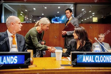 Minister of Foreign Affairs Stef Blok and Amal Clooney (R) meet a representative for the United Nations Assistance Mission for Iraq during the meeting on ISIS at the United Nations headquarters.