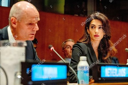 Stock Photo of Minister of Foreign Affairs Stef Blok and Amal Clooney (R) during the meeting on ISIS at the United Nations headquarters.