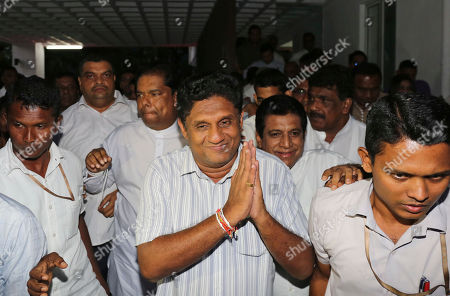 Deputy leader of Sri Lanka's governing United National Party Sajith Premadasa, center, greats media as he walks out of their party office after being nominated as the presidential candidate in Colombo, Sri Lanka, . Sri Lanka's governing party on Thursday named its charismatic deputy leader, Sajith Premadasa, as its candidate in November's presidential election, ending a long tussle with the party leader, Prime Minister Ranil Wickremesinghe, over the nomination