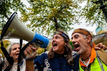 Protesters signing a Brazilian song through a megaphone, during the demonstration. After Arnhem-based artist, Rob Voerman opened a petition to save the Amazon and to stop Bolsonaro which has already been signed more than 8,100 times, he organized a demonstration with other supporters in The Hague against the policies of Brazilian President, Jair Bolsonaro and against the Mercosur Free Trade Treaty. After the demonstration a petition was offered to the Brazilian ambassador and Sigrid Kaag, Minister for Foreign Trade and Development Cooperation.