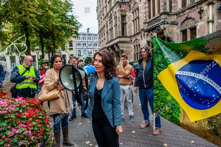 Esther Ouwehand, one of the five Members of Parliament of the Party for the Animals speaking on a megaphone during the demonstration. After Arnhem-based artist, Rob Voerman opened a petition to save the Amazon and to stop Bolsonaro which has already been signed more than 8,100 times, he organized a demonstration with other supporters in The Hague against the policies of Brazilian President, Jair Bolsonaro and against the Mercosur Free Trade Treaty. After the demonstration a petition was offered to the Brazilian ambassador and Sigrid Kaag, Minister for Foreign Trade and Development Cooperation.