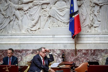 French National Assembly president Richard Ferrand sits near French and European flags attached by a black mourning ribbon inside the French National Assembly following the death of French former president Jacques Chirac in Paris, France, 26 September 2019. Chirac died peacefully surrounded by his family, aged 86. The former French president Jacques Chirac's health was troubled ever since a 2005 stroke he suffered while still in office. He was head of state from 1995 to 2007, was twice president, twice prime minister and 18 years mayor of Paris.
