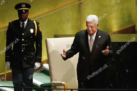 Palestinian President Mahmoud Abbas acknowledges delegates' applause before his addresses to the 74th session of the United Nations General Assembly