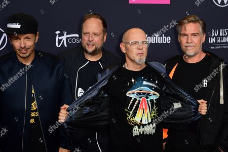 Musicians of the German group Die Fantastischen Vier, Michael Beck aka Michi Beck, Michael Bernd Schmidt aka Smudo, Thomas Duerr aka Thomas D, and Andreas Rieke aka And.Ypsilon pose on the red carpet of the 'YouTube Goldene Kamera Digital Award 2019' ceremony in Berlin, Germany, 26 September 2019. The best German web video producers will be awarded at the event.