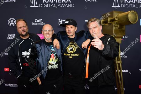 Musicians of the German group Die Fantastischen Vier, Michael Bernd Schmidt aka Smudo, Thomas Duerr aka Thomas D, Michael Beck aka Michi Beck and Andreas Rieke aka And.Ypsilon pose on the red carpet of the 'YouTube Goldene Kamera Digital Award 2019' ceremony in Berlin, Germany, 26 September 2019. The best German web video producers will be awarded at the event.