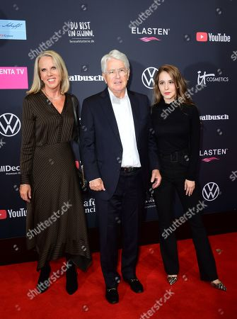 German TV host Frank Elstner (C), his wife Britta Gessler (L) and daughter Enya Elstner pose on the red carpet of the 'YouTube Goldene Kamera Digital Award 2019' ceremony in Berlin, Germany, 26 September 2019. The best German web video producers will be awarded at the event.