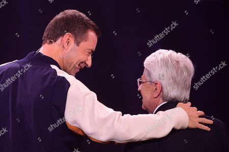 German TV host Kai Pflaume (L) leads German TV host Frank Elstner on stage prior to honoring him with the 'Best Newcomer' award during the 'YouTube Goldene Kamera Digital Award 2019' ceremony in Berlin, Germany, 26 September 2019. The best German web video producers are awarded at the event.