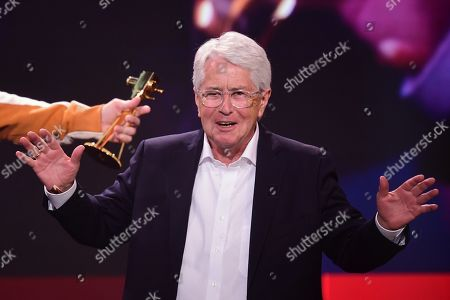 German TV host Frank Elstner gestures prior to receiving the 'Best Newcomer' award during the 'YouTube Goldene Kamera Digital Award 2019' ceremony in Berlin, Germany, 26 September 2019. The best German web video producers are awarded at the event.