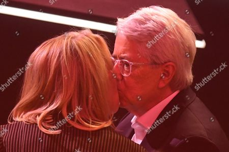 German TV host Frank Elstner (R) kisses his wife Britta Gessler (L) after to receiving the 'Best Newcomer' award during the 'YouTube Goldene Kamera Digital Award 2019' ceremony in Berlin, Germany, 26 September 2019. The best German web video producers are awarded at the event.