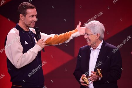 German TV host Frank Elstner (R) smiles after receiving the 'Best Newcomer' award from German TV host and laudator Kai Pflaume (L) during the 'YouTube Goldene Kamera Digital Award 2019' ceremony in Berlin, Germany, 26 September 2019. The best German web video producers are awarded at the event.
