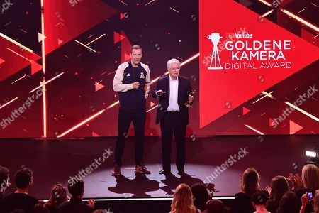 German TV host Frank Elstner (R) is applauded after receiving the 'Best Newcomer' award from German TV host and laudator Kai Pflaume (L) during the 'YouTube Goldene Kamera Digital Award 2019' ceremony in Berlin, Germany, 26 September 2019. The best German web video producers are awarded at the event.