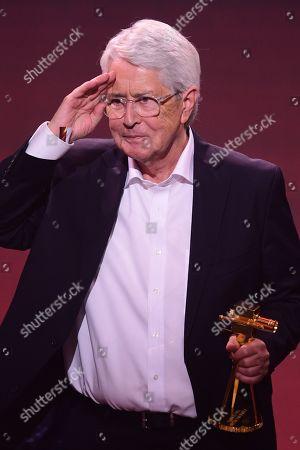 German TV host Frank Elstner gestures after receiving the 'Best Newcomer' award during the 'YouTube Goldene Kamera Digital Award 2019' ceremony in Berlin, Germany, 26 September 2019. The best German web video producers are awarded at the event.