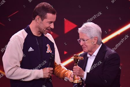 German TV host Frank Elstner (R) receives the 'Best Newcomer' award from German TV host and laudator Kai Pflaume (L) during the 'YouTube Goldene Kamera Digital Award 2019' ceremony in Berlin, Germany, 26 September 2019. The best German web video producers are awarded at the event.
