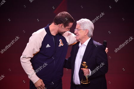 Stock Picture of German TV host Frank Elstner (R) receives the 'Best Newcomer' award from German TV host and laudator Kai Pflaume (L) during the 'YouTube Goldene Kamera Digital Award 2019' ceremony in Berlin, Germany, 26 September 2019. The best German web video producers are awarded at the event.
